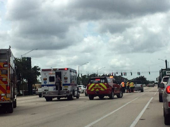 Emergency vehicles block the center lane for southbound traffic on U.S. 41 north of Immokalee Road in North Naples after a crash Friday afternoon, July 7, 2017.