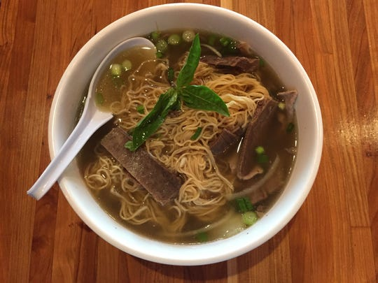 The new Creazian restaurant features build-your-own pho with choices of broth, noodle and protein. Here, beef broth pho with flank, rare steak and brisket.