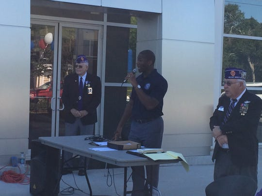 Mayor Andrew Gillum speaks Friday to the crowd at the Purple Heart Run event hosted by the Ford dealership on Magnolia Street.