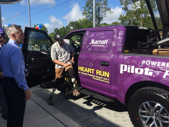 Justin Burdette demonstrates how to use the Purple Heart Run modified truck.