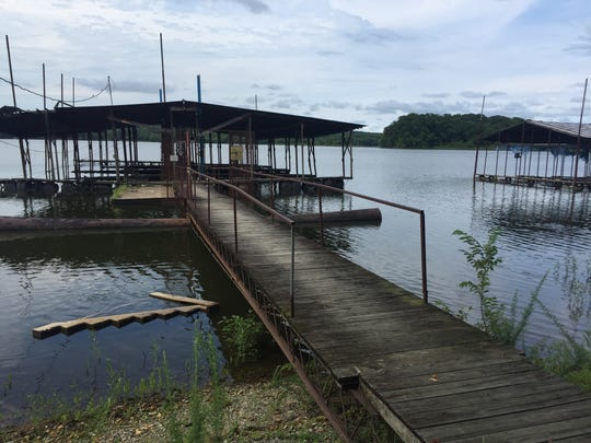 Covered boat slips at Cane Creek Boat Dock have fallen