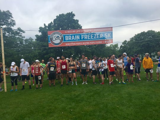Runners line up at the beginning of the Brain Freezer 5K on Saturday July 8, 2017
