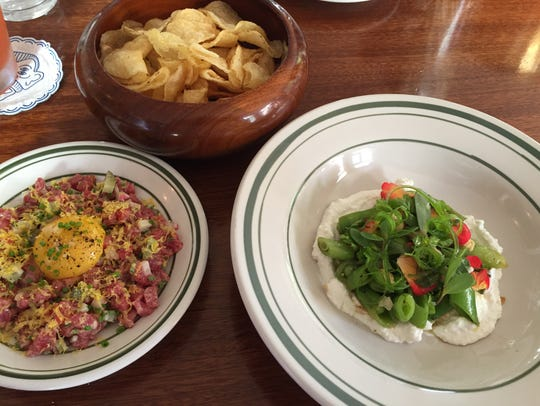 Beef tartare, left, and purslane and snap pea salad,