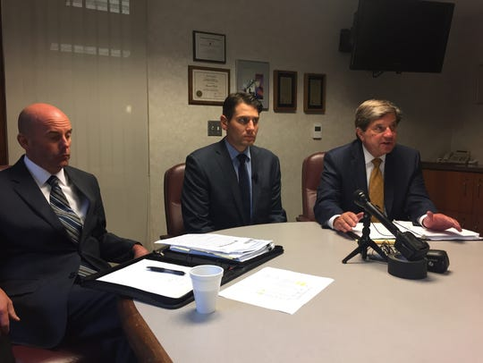 Sterling Heights Mayor Michael Taylor sit between the city manager (on left) and a city attorney last year to discuss the city's lawsuit against Macomb County over who should pay for last year's giant sinkhole and sewer repair in Fraser.