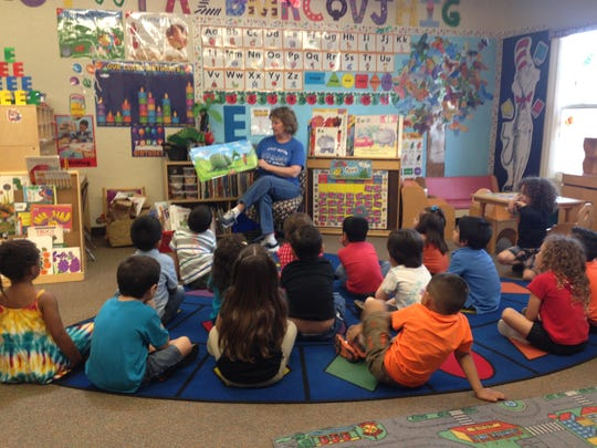 A classroom instructor reads to students in a Desert Sands Early Childhood Education program.