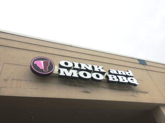 Oink and Moo BBQ is located in the Ritz Shopping Center at  910 Haddonfield-Berlin Road, not far from the AMC 16 movie theater.