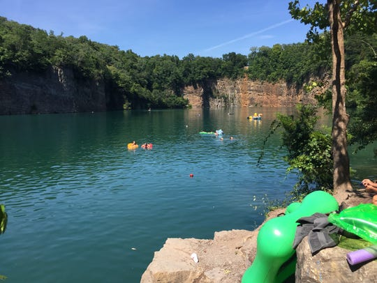 Swimmers enjoy fun on the water at Fort Dickerson Park.