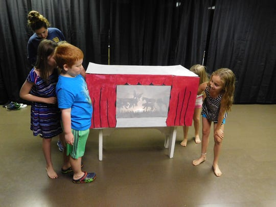 Campers at Making Light Productions learn about the