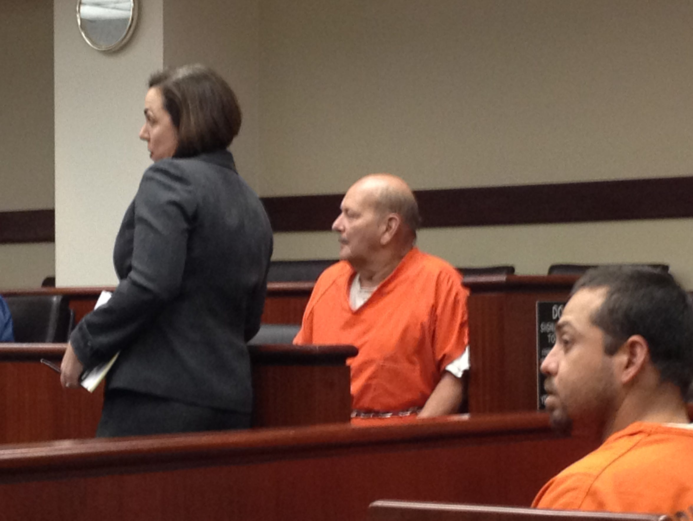 Michael Jerome Hayes, center, appears at a court hearing