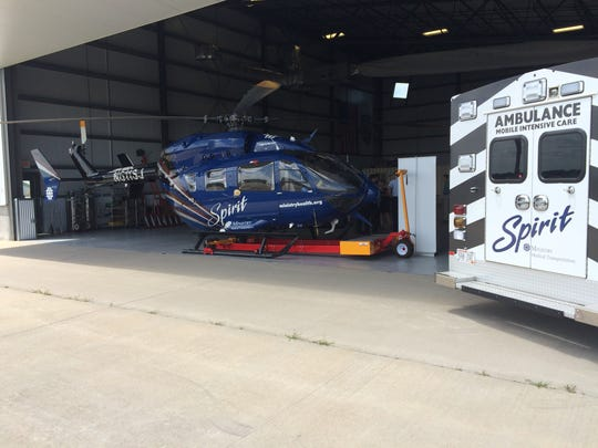 A helicopter and ambulance for Ministry Spirit Medical Transportation Services sit in a hangar at the Stevens Point Municipal Airport on July 12, 2017. The service has been relocated from Marshfield.