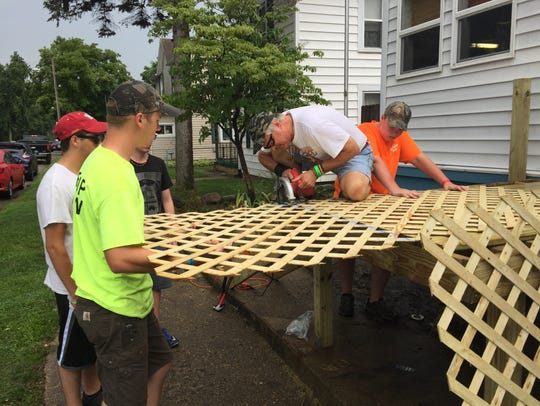 TeenServe youths repair city resident Mary Willoughby's