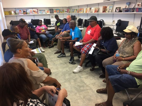 Members of the Cantonment Improvement Committee hold a meeting July 10, 2017, to discuss the area's need for a new community center.