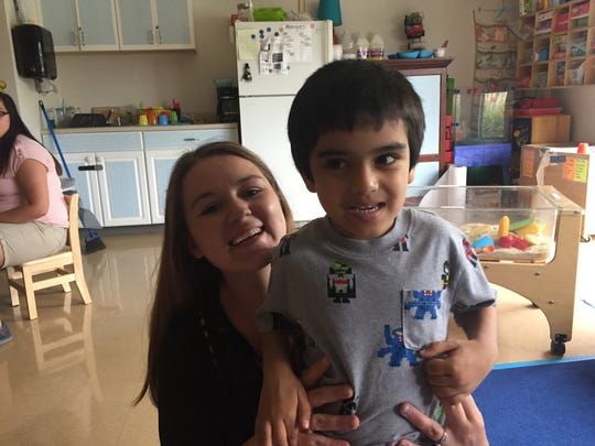 Vivann Dholakia with occupational therapist Jessica Davis at CP Rochester on July 11, 2017.