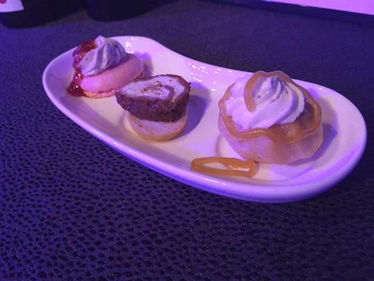 This cheese trio, part of the 2017 Epcot International Food and Wine Festival menu, features a unique take on a cream puff and a strawberry macaron with a cheese topping.