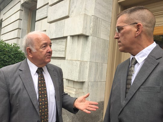 Milton resident David Ballard, right, talks with his lawyer, Norman Blais on Friday outside Vermont Superior Court in Burlington. David Ballard is fighting a Vermont Department of Health decision to withhold his driver's license due to his use of medical marijuana to treat ALS symptoms. Photographed on July 14, 2017.