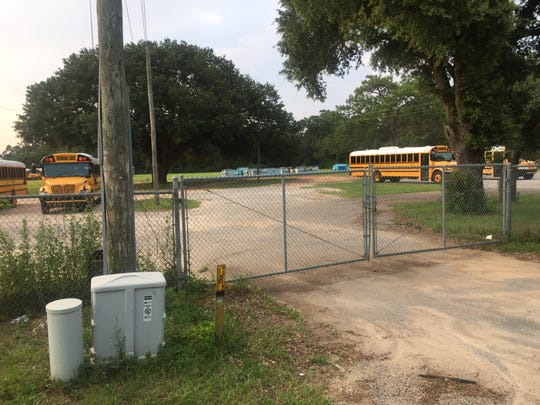 The Escambia County School District is currently using a lot off Muscogee Road to store buses. A volunteer group called the Cantonment Improvement Committee is hoping to utilize a portion of the lot for a new community center.