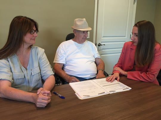 Jeni Pegram (left) and attorney Aimee Luna of Legal Aid Society assist 75-year-old veteran Larry Cook with the appeals process after TennCare determined he was ineligible for a Medicare subsidy and his Social Security benefits were cut.