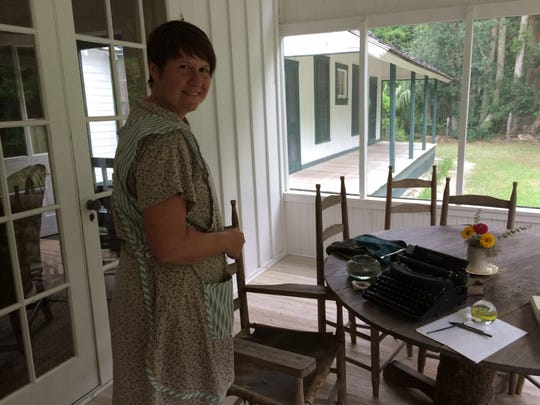 : Carrie Todd, Park Ranger at Marjorie Kinnan Rawlings Historic State Park in Cross Creek, stands on the front porch of the writer's home