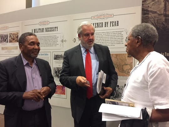 Frank Smith, left, Bill Luckett, center, and Timothy Jenkins chat after a panel at the African American Civil War Museum on Rust College and its role in the civil rights movement.