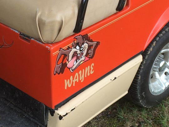 One of two decals on Wayne and Donna Groves' golf cart.