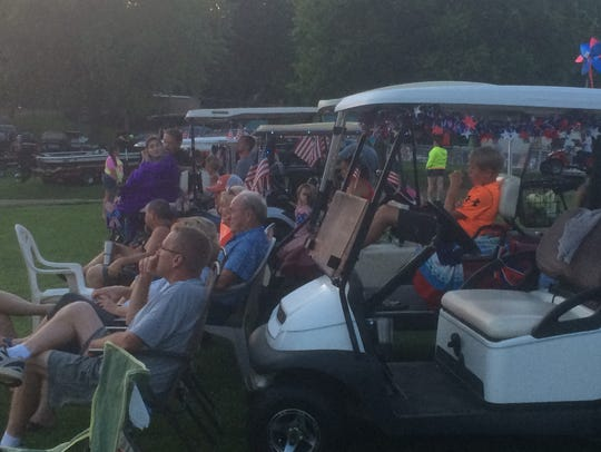Residents gather with their golf carts at Kentucky