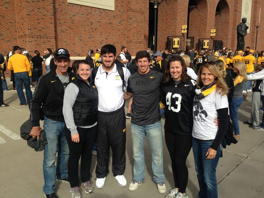 The Jewell family gathers outside Kinnick Stadium,