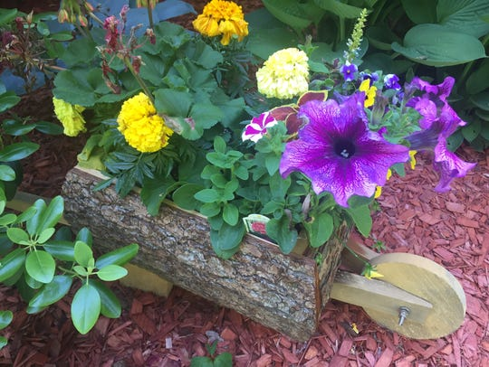 this handmade Amish planter with annual flowers found