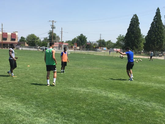 Matheus Silva (blue shirt) practices with the Reno 1868 FC on Friday at the Moana Field.