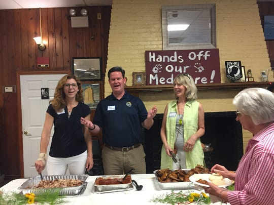 County Commissioners Kristin Dozier, John Dailey and Mary Ann Lindley were among the servers at the DCNF's annual summer picnic and political rally on Saturday.