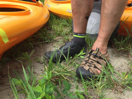Domenic Grasso of Shelburne models the footwear best suited to the Winooski Pedal and Paddle event Sunday that looped between Burlington's Intervale and the Winooski shoreline. Photographed July 23, 2017.