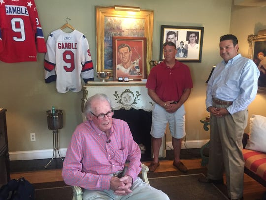 Amerks legend Dick Gamble, 88, talks to media at Waterlilly Day Spa where he was reunited with his lost 2007 AHL Hall of Fame ring. Son Craig, right, lost the ring while swimming in Canandaigua Lake three years ago. It was found over July 4 weekend by Auburn scuba diver Gary Gavurnik, center.
