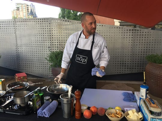 Chef Christian Christensen of Süp cooks during the finale of Chefs Al Fresco on July 24, 2017, on the terrace of Campo Reno.