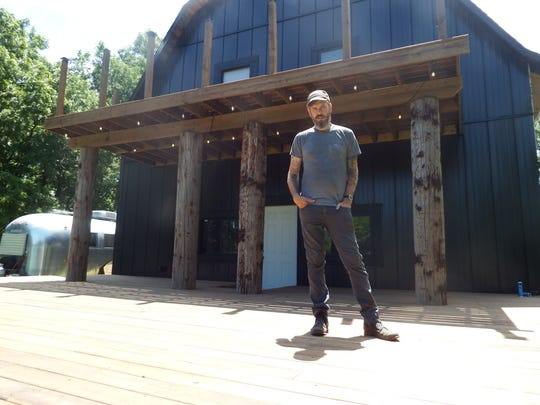Luke Tweedy stands on the stage attached to his Lone Tree music studio Flat Black Studios on July 7, 2017.  The stage will host a series of musicians during the first Grey Area music festival, which will be held Aug. 18-19.