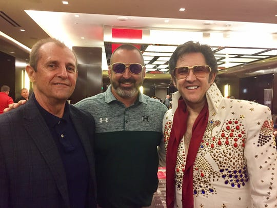 Nick Rolovich, center, and the Elvis impersonator he