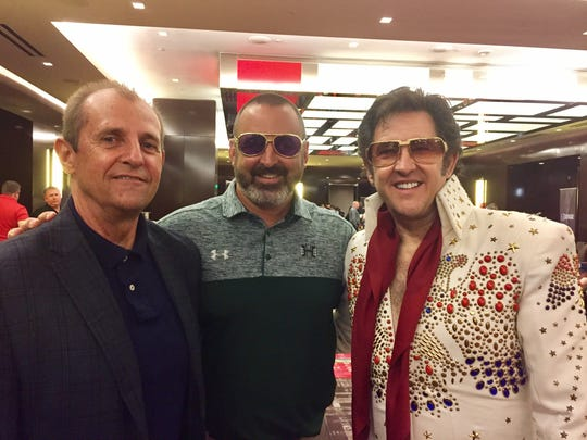 Nick Rolovich, center, and the Elvis impersonator he hired to follow him around at the Mountain West Media Summit.