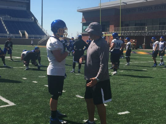 Defensive end Chase Kern (L) discusses a drill with defensive coordinator Clint Brown Wednesday at Dana J Dykhouse Stadium