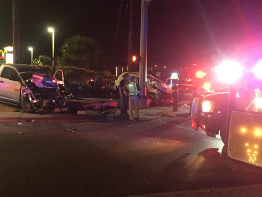 A woman was pronounced dead at the scene of a three-vehicle