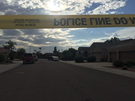Police at the scene of a baby found in a hot car in