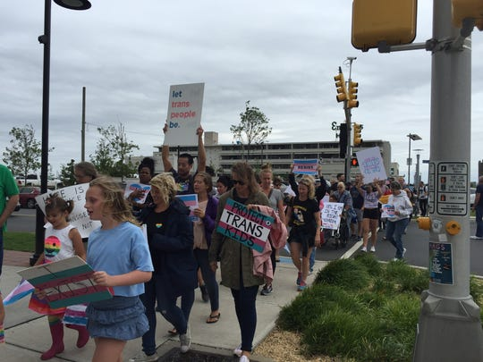 Marchers for transgender military rights take off down Cookman Avenue to Liberty Square Park during a rally in Asbury Park on July 29, 2017.