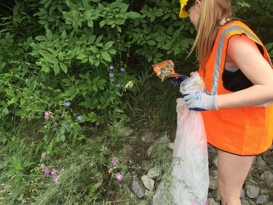 Cheerleader Emily Carr finds an empty Doritos bag in the bushes along Route 22.