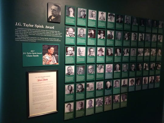 Baseball writer Claire Smith's photo is added to the array of winners of the J.G. Taylor Spink Award at the National Baseball Hall of Fame in Cooperstown, N.Y.