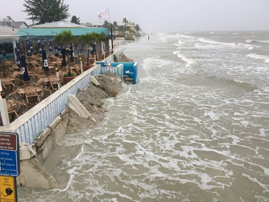 Waves from Tropical Storm Emily crash at Fort Myers