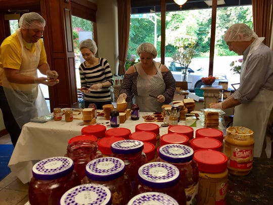 Volunteers make 500 peanut butter and jelly sandwiches