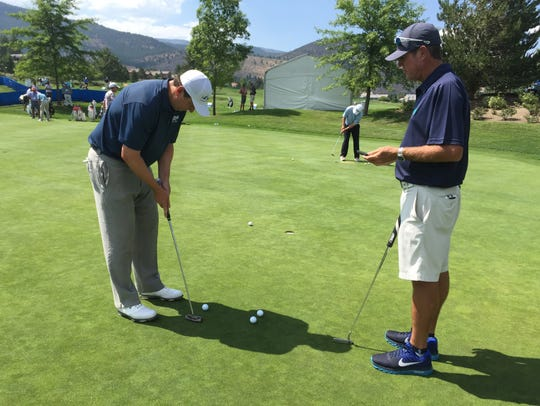 JJ Henry works in his putting Monday at Montreux Golf