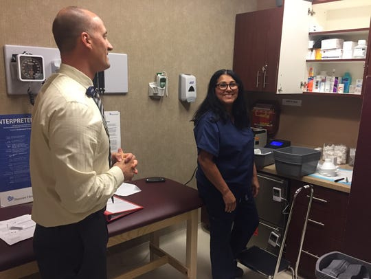 Family nurse practitioner Rebecca Gonzalez, left, talks