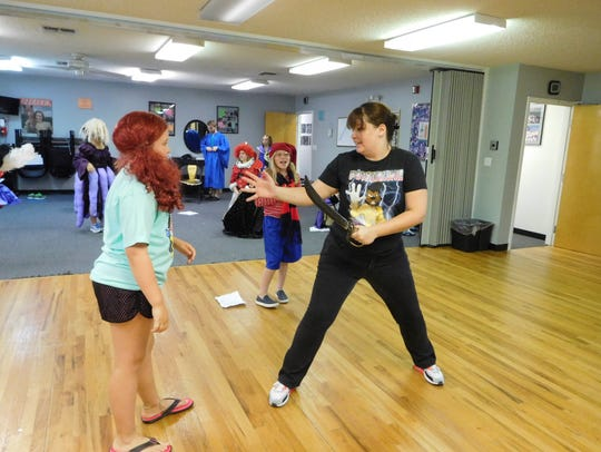 Katie Seitzinger demonstrates a choreographed sword