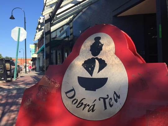 A sign on the Church Street Marketplace promotes Dobra Tea on Bank Street. A second Vermont location of Dobra Tea is now open in Winooski.