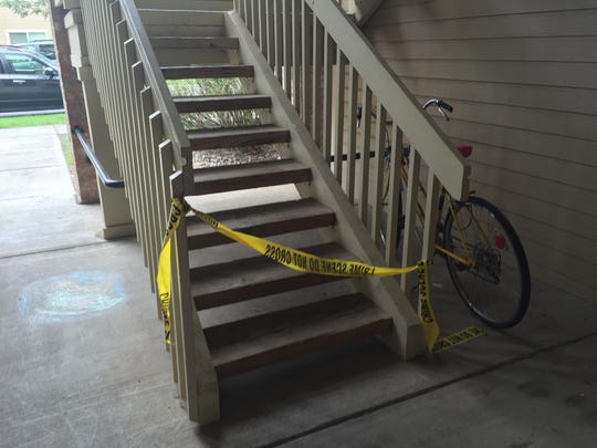 The staircase leading up to the deceased person's apartment was blocked off with crime scene tape Thursday, Aug. 3, 2017.