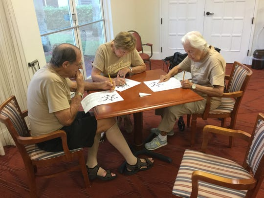 Panthers team members work on a crossword puzzle during