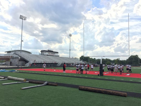 New Albany football practice wraps up Tuesday afternoon as 6-foot segments of utility poles lie parallel to the sideline.